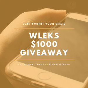 Wleks featured image for their $1000 worldwide giveaway. For their promo photo they have used old iphone photo with text on the display, which states that they are running a giveaway for which you can participate worlwide. And ofcourse they have used a slight filter for this photo.
